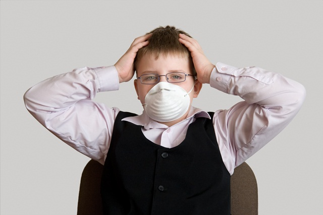 Ecological threat. The little boy in a respirator.